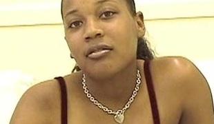 Ebony babe around big tits uses vibrator on the brush cunny
