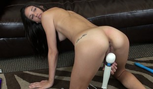 Thin brunette Tiffany Thompson uses her vibrator and poses her body