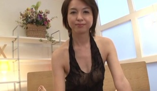 Japanese brunette with natural tits gives skillful handjob