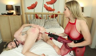 The mistress gags her female menial and drills her with a strapon