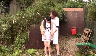 petite japanese teenager wearing down cock outside