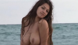 Beautiful busty Sofi posing connected with nature